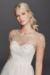 A bride in crystal body jewelry by David's Bridal. (Style 212420)