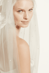 The Starry Night cathedral veil covered with crystals. This David's Bridal veil is offered in ivory. (Style VSWG560)