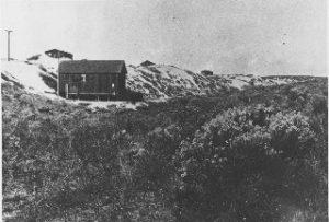 Building and sand dunes looking North from 15th St. & Valley Dr. - circa 1917