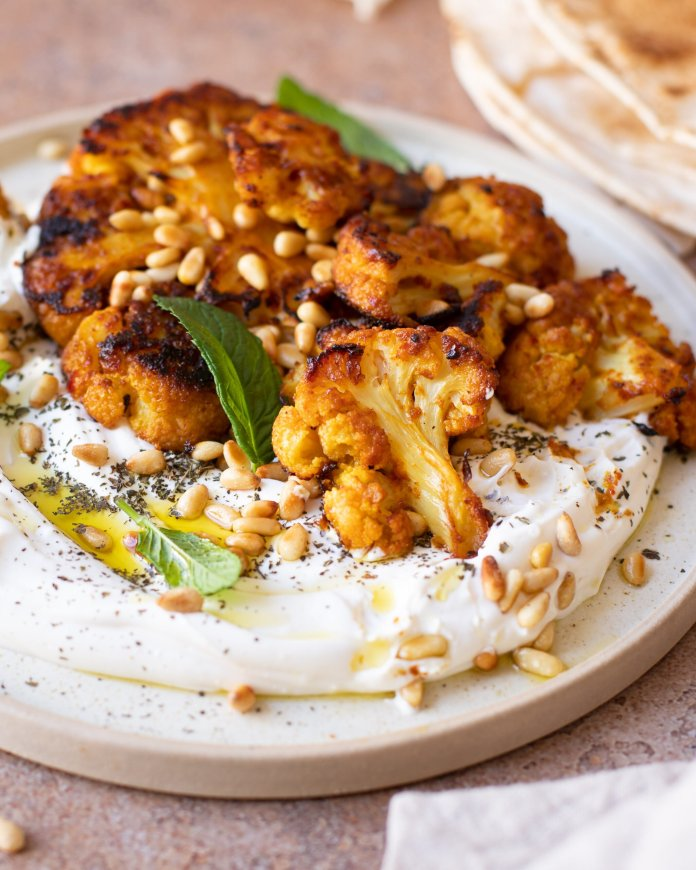Lemon Steamed & Harissa Roasted Cauliflower served over Vegan Feta-Yogurt Cream with Agave & Mint