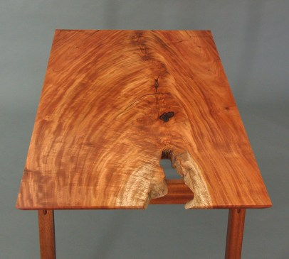 The client's chief wish was a beauitful piece of wood. When I found this wide slab of crotch-grain Belize mahogany, I knew we had it. The natural hole can double as a catch for computer cords!