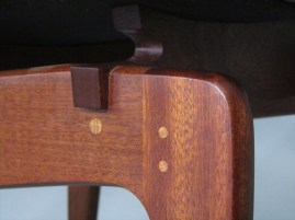 The hidden mortise-and-tenon joint in the knee is drawbored with dowels for extra strength.