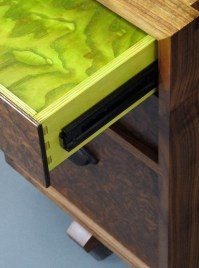 Bright green finger joints in birch plywood.