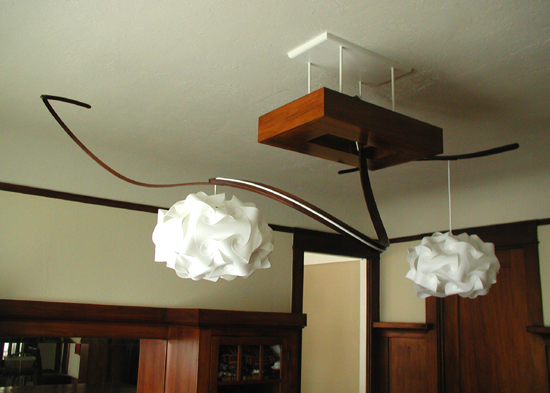 The gumwood fixture ties into the craftsman-style built-ins, which are also gumwood.