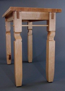 "The legs and apron are connected with joints technically called ""double interlocking through tenons."""
