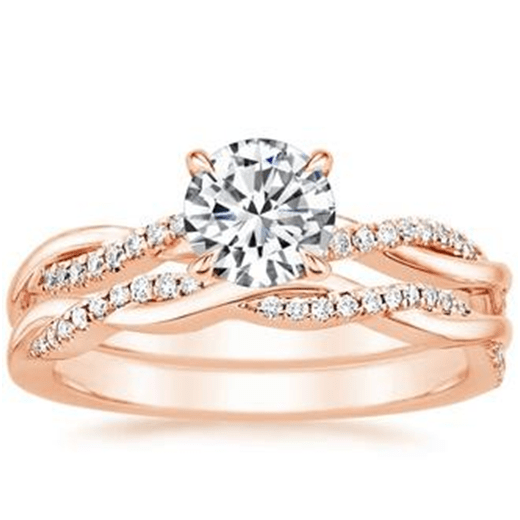 The addition of a Rose Gold wedding ring produces a magnificent ring set