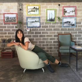 Jet Metier posing in a comfortable couch in Mexico