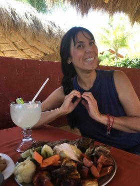 Jet Metier making a heart sign over food in Mexico