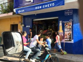 Young family on their motorcycle in Mexico street