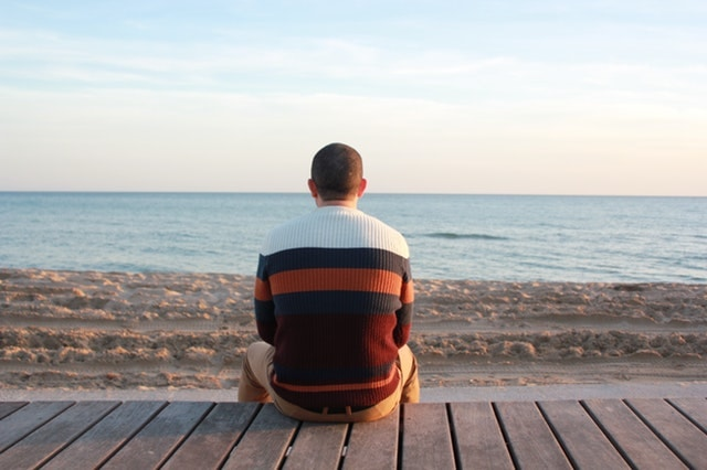 Man sitting on wooden panel-Vacation rentals