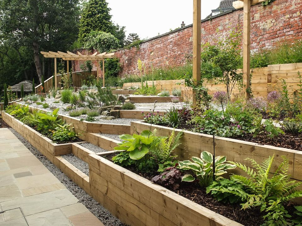 Modern Garden with a rustic twist | Sloped garden, Modern ... on Tiered Yard Landscaping id=53475