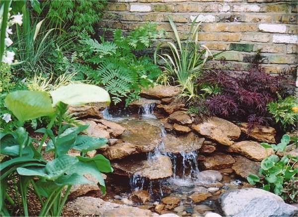 22 Beautiful Waterfalls for Natural Backyard and Front ... on Front Yard Waterfall Ideas id=94628