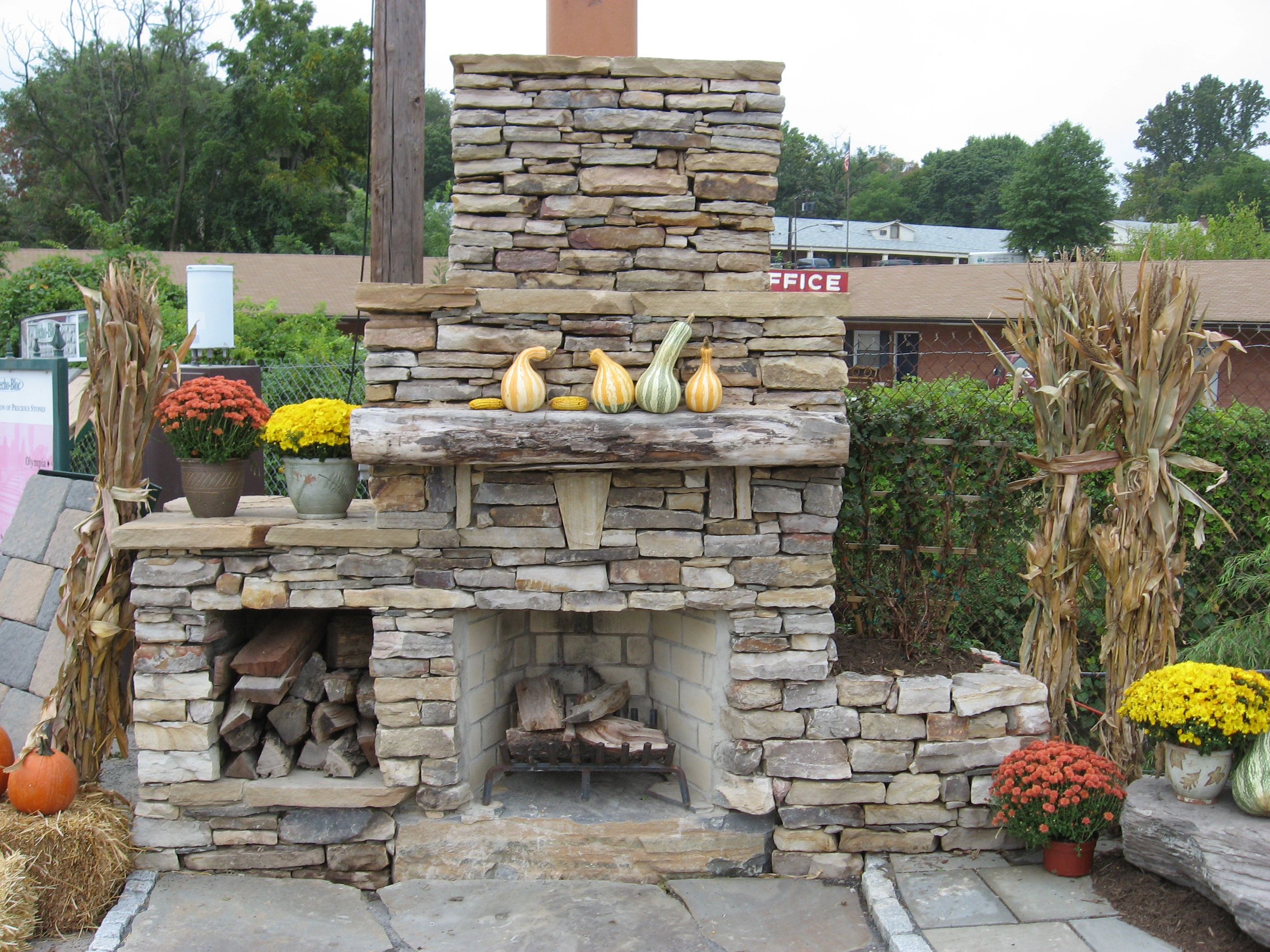 Outdoor Stone Fireplace Warming Up Exterior Space - Traba ... on Outdoor Kitchen And Fireplace Ideas id=66509