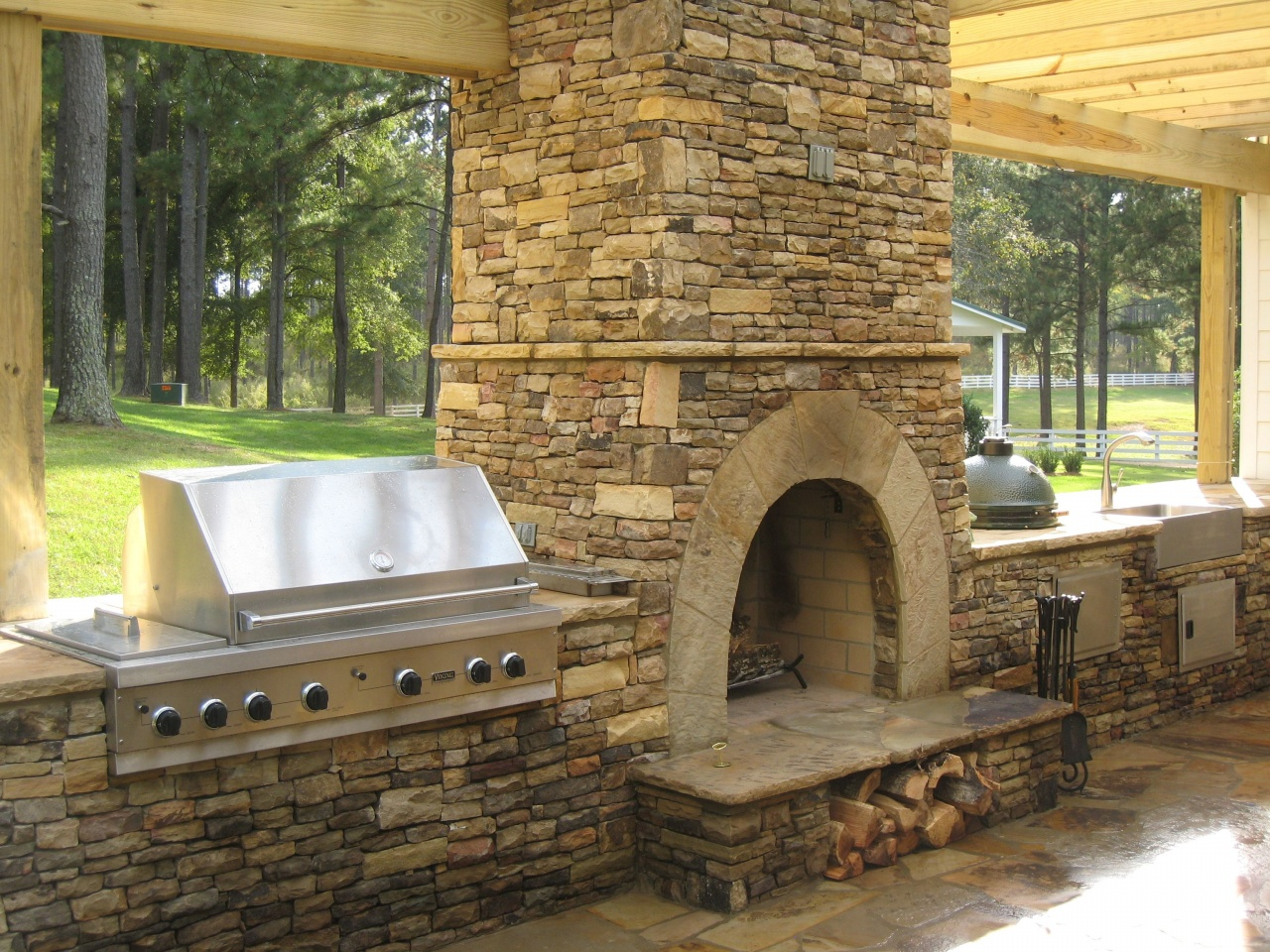 How Much Does It Cost to Build An Outdoor Fireplace ... on Outdoor Kitchen And Fireplace Ideas id=13004