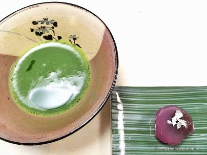 Green matcha tea with red sweet bean paste.