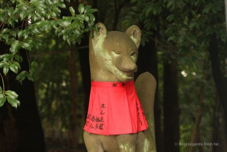 Fox guardian outside the gates to the Inari shrine, Kyoto.