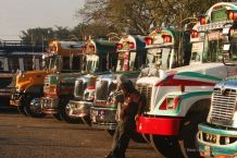 Chicken buses lined up at the terminal, Antigua, Guatemala