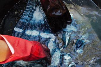 Washing the indigo scarf, natural dyeing and weaving workshop Vientiane, Laos
