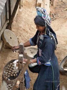 Akha woman processing cotton, Akha village trek, Laos