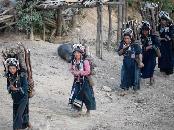 Akha women coming home after fetching fire wood, Akha village, Laos