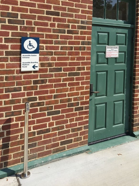 Amtrak Camden, SC Station ADA push-button door open assembly with braille photopolymer signage
