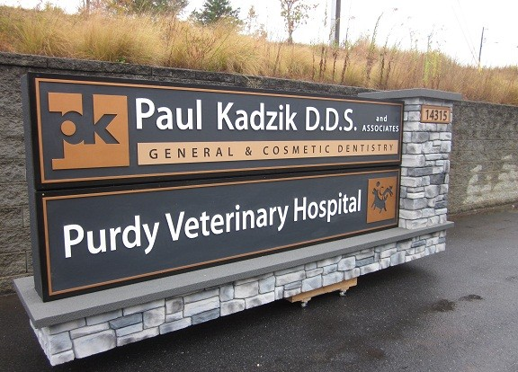 Outdoor Business Signs with Faux Rock
