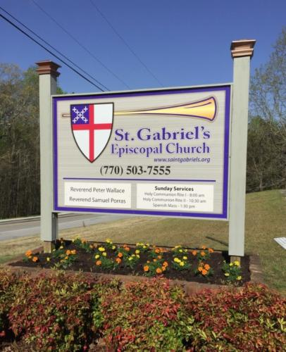 After - Saint Gabriel's Church aluminum sign panel to look like sandblasted sign, with changeable service hours and pastor name.