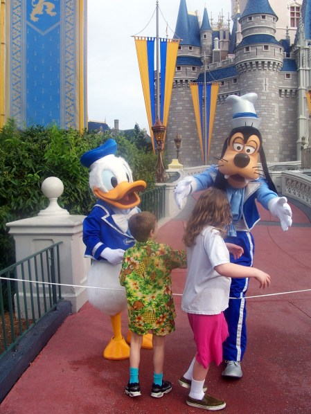 Donald and Goofy greet Carly and Nathan