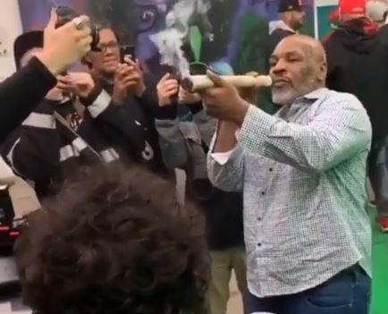 Mike Tyson smoked the huge joint while people took his picture. Credit: Instagram/cmw420tv