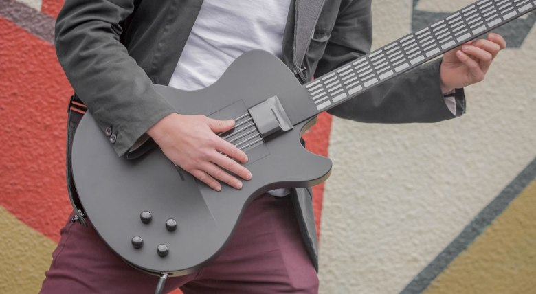 press a button, play a chord on magic instruments' digital guitar