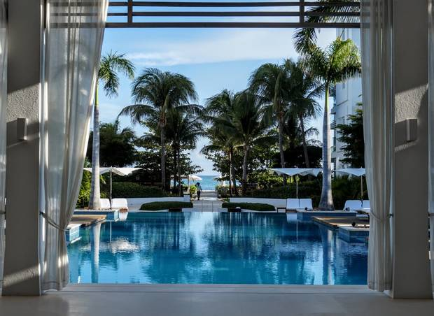 At Gansevoort Hotel, Turks and Caicos, white steps lead up to an open-air lobby that flows through to the infinity pool.