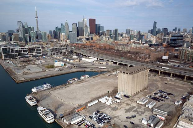 An aerial view of what the Toronto waterfront area looks like now. The Globe and Mail's dark blue building is visible at right.