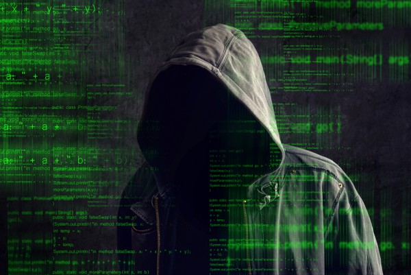 Faceless cyber criminal hacker