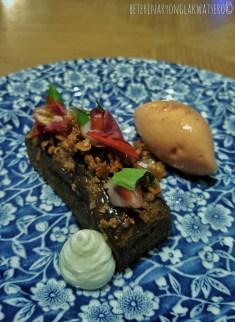 Delish pink guava sorbet in black sesame cake.