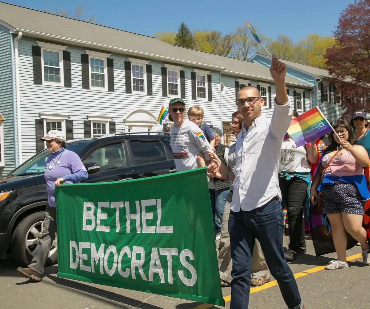 Parade participants at the Bethel CT Pride LGBTQ+ parade celebrating gay, trans, lesbian, genderqueer, intersex, transgender, queer, and human rights in northwestern Connecticut