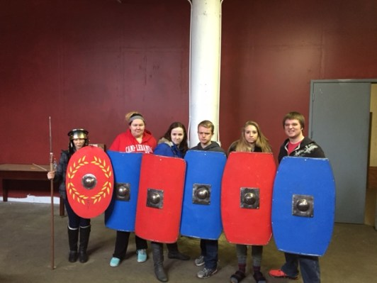 Prof. Hage and five of her students holding replicas of Roman shields