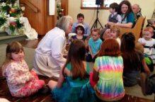 Bethel children gather around the pastor.