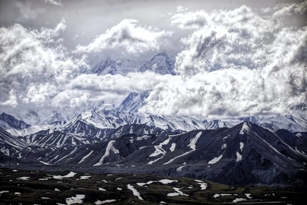 Denali Mountain with its peak in the clouds.