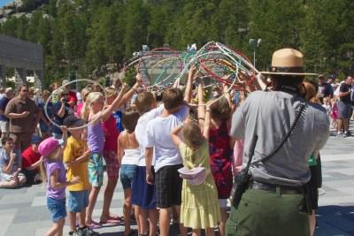 Mount Rushmore Jasmine Pickner hoop dance with kids 3 July 2011 (1)