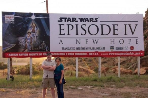 Todd and Beth in front of Navajo Star Wars sign, Arizona, July 2013