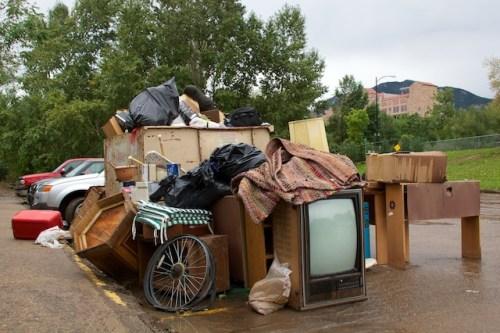 Boulder floods, dumpster, trash