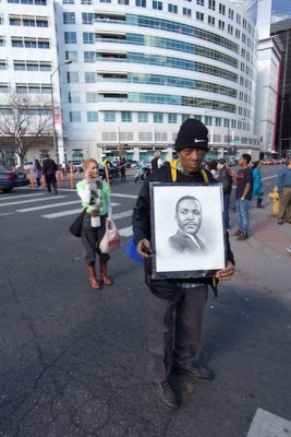 Denver Marade marcher with MLK picture in front of Denver Post building, Jan 2015