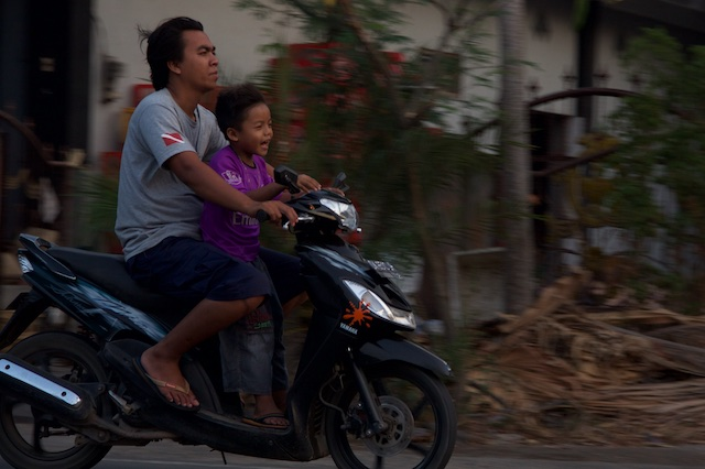 Ojek with grinning kid Indonesia Oct 2015