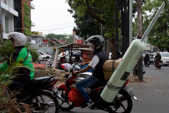 Ojek with rocket or needle Indonesia Oct 2015