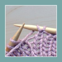 Between two purl stitches.