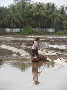 Woman working in the salt fields.