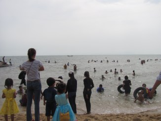Cambodians celebrating Chinese New Year at Kep Beach.