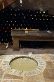 The sealed hole is where they age their casks of wine.