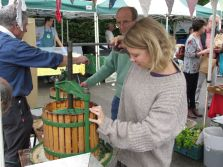 Pressing apples at the Cowbridge Farmers Market in Wales.