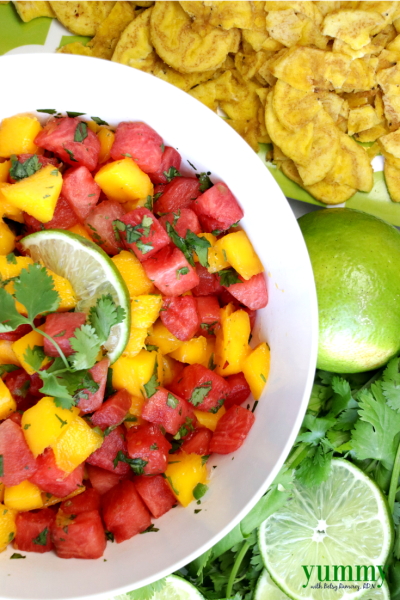bowl of watermelon salsa with chips and lime